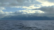Stormy weather in Swiss Alps, thick clouds covering sky, lake waves splashing video