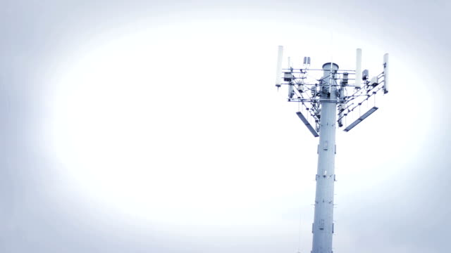 Stormy weather plagues tall steel gray radio tower during daytime video