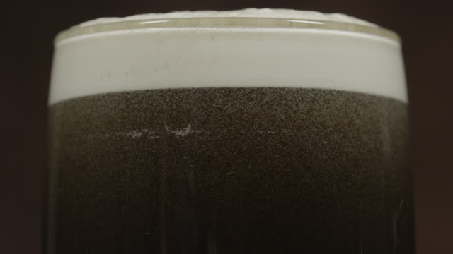 Stout dark beer in a pint glass panning video
