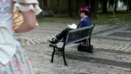 stranger woman sat down on a bench to the man video