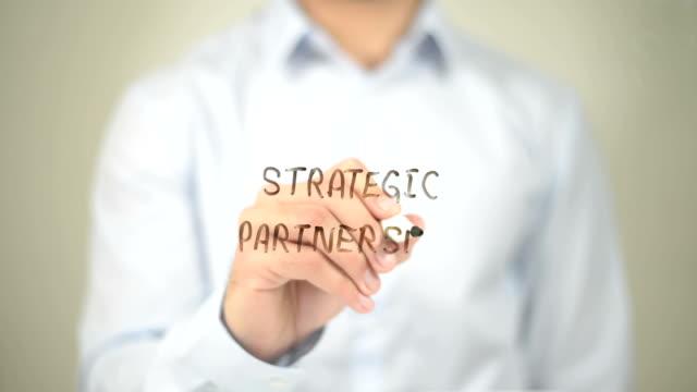 Strategic Partnership, Man Writing on Transparent Screen video