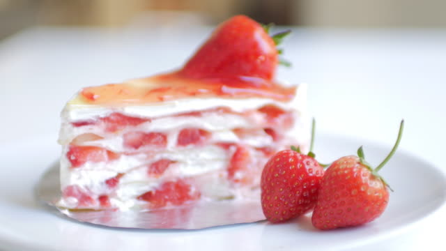 Strawberries crepe cake with strawberry cream with dolly shot movement video