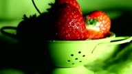 strawberries in a small colander video