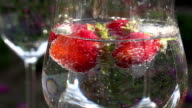 Strawberry Rotates in a Glass with Water video