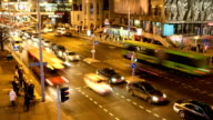 Stream of cars through the pedestrian crosswalk. Blurred motion. Timelapse shot. video