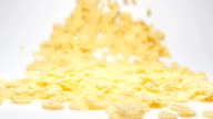 SLOW MOTION: Stream of  corn flakes moving to a camera video