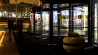 stream of people in revolving door of hypermarket time lapse video