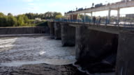 Streams of water on the river dam splashing out from under the gate video
