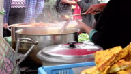 street food serving on a live event: stand of asian street food video