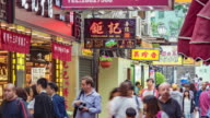 street in macao china.This street is full of shop,every day a lot of peoples come here to shopping. video
