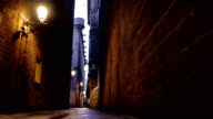 Street in the Gothic quarter of Barcelona at night, dolly video