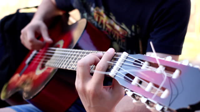Street musician play on guitar video