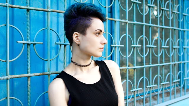 Street punk or hipster girl with blue dyed hair video
