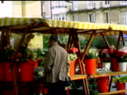 Street scene with flowers and couple in San Sebastian Spain video