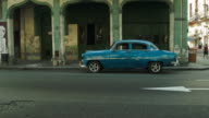 Street side view of classic american cars and buildings in Havana video