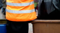 Street sweeper cleaning waste container in city square, working hard video