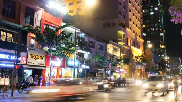 HO CHI MINH / SAIGON, VIETNAM - 2015: Street traffic asian city night time lapse video