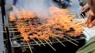 Street Vendor Cooking Grilled Pork video