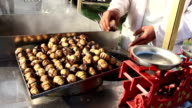 Street vendor roasting chestnuts video