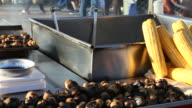 Street vendor sells boiled corn and roasted chestnut video