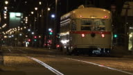 PCC streetcars transportation in San Francisco downtown city at night video