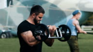 Strength training at a military base video