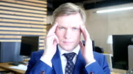 Stressed and tired business man video