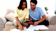 Stressed couple because of bills to pay video