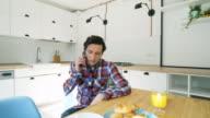 Stressed man talking at mobile phone. video