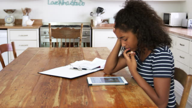 Stressed Teenage Girl With Digital Tablet Revising For Exam video