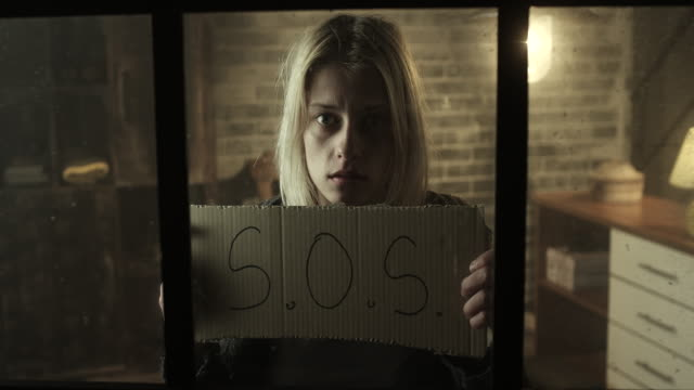 Stressed women holding S.O.S. sign video
