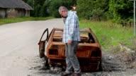 Stressful man near car wreck video