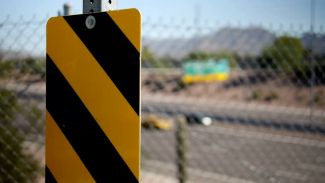 Striped Caution Sign and Desert Highway Scene video