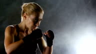 Strong blows by hands with fists of boxer sporswoman video