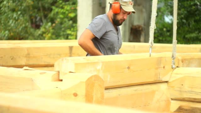 Strong lumberjack chopping wood video
