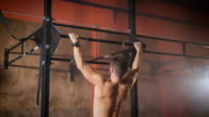 Strong man doing pull ups video