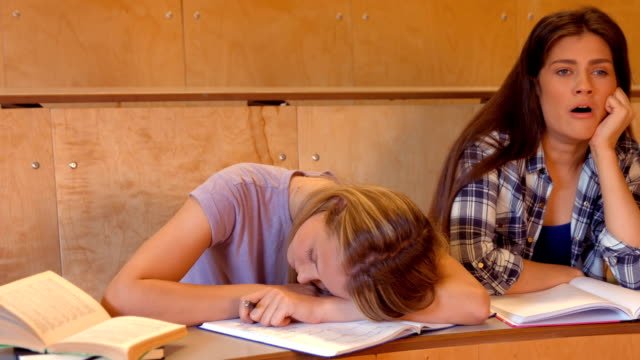 Student asleep with partner on the verge video