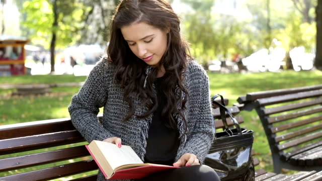 Student girl reading textbook video