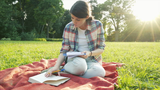 Student girl studying in park. video