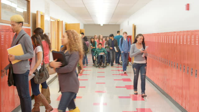 Student in wheelchair goes down hall video