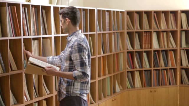 Student looking for a book in the library video