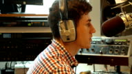 Student presenting a radio show in studio video