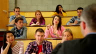 Student raising her hand to ask question in lecture video