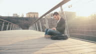 WS Student Rejoicing While Using Laptop On Bridge video