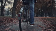 Student riding a bicycle through the park video