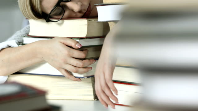 HD DOLLY: Student Sleeping On Books video