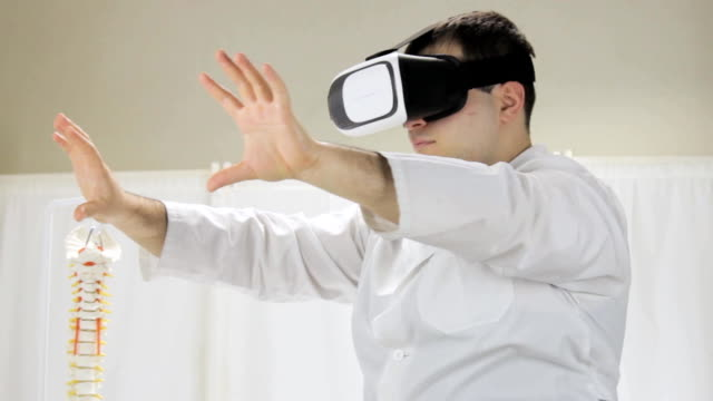 Student studying medicine, via virtual reality glasses video