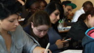 Student uses cellphone to text during lecture video