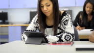 Student uses Digital Tablet Computer in Classroom video
