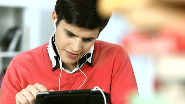HD: Student Using Digital Tablet In The Library video